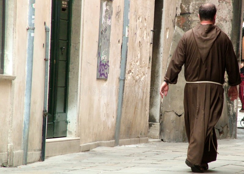 Priest strolling stock images