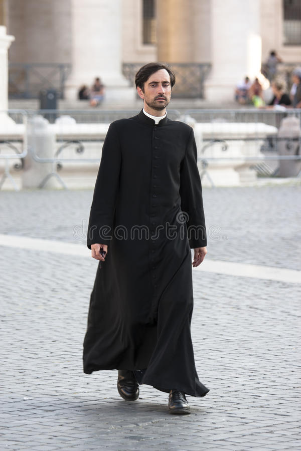 Priest walking (Vatican City) royalty free stock image