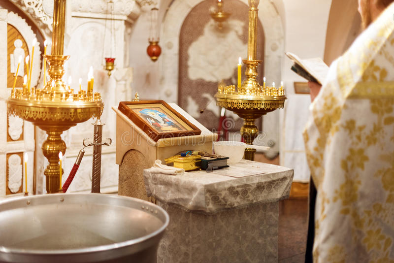 Priest wearing gold robe on ceremony in christian cathedral church, holy sacramental event. Priest wearing gold robe on ceremony in christian cathedral church royalty free stock image