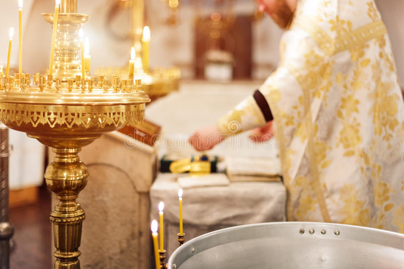 Priest wearing gold robe on ceremony in christian cathedral church, holy sacramental event. Priest wearing gold robe on ceremony in christian cathedral church stock photo