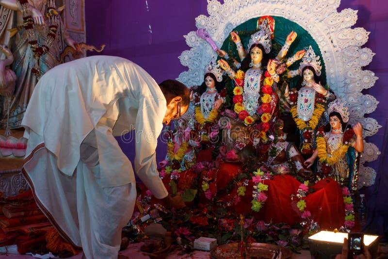 Priest worshiping in Hindu temple stock image