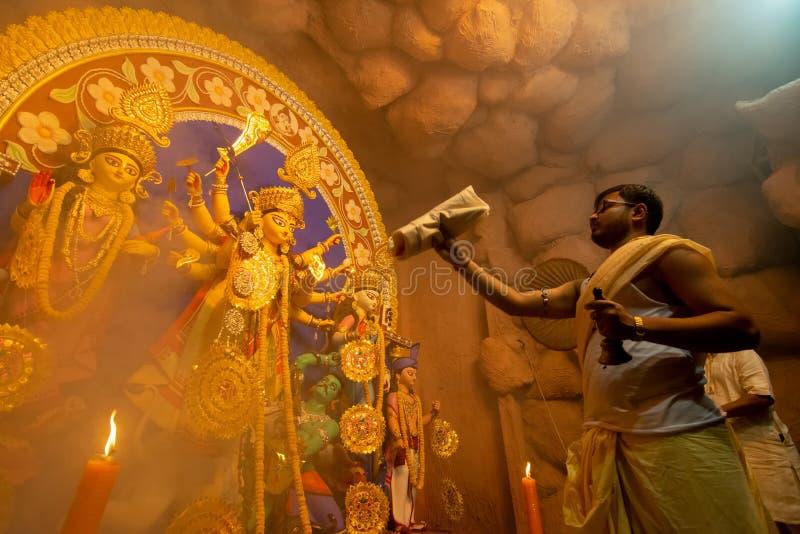 Priest worshipping Goddess Durga, Durga Puja festival celebration royalty free stock photography