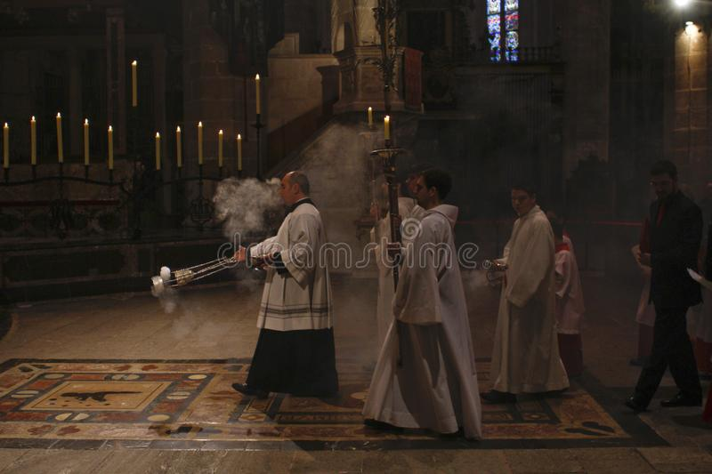 Priests at mass in Palma de Mallorca cathedral. Priests and altar boys queue as they wait for the start of a sunday palm ceremony during Holy week celebrations royalty free stock image