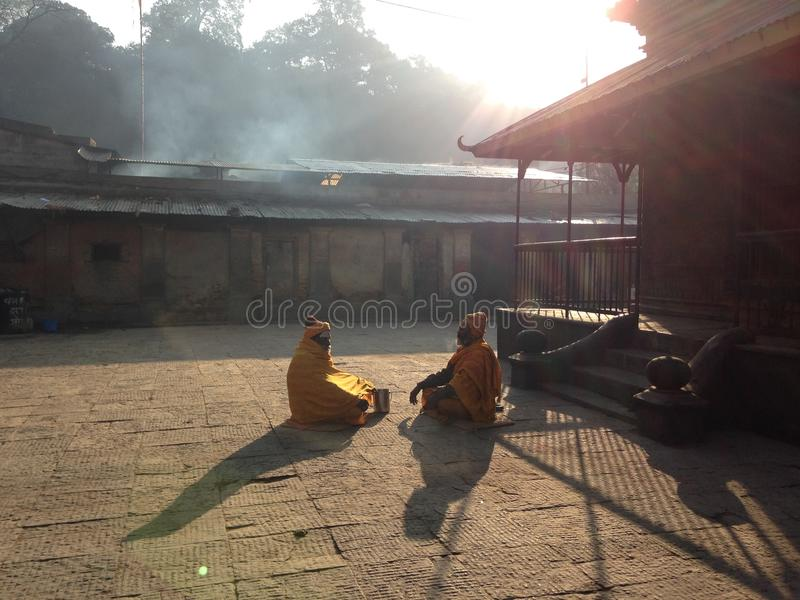 Priests inside the Pashupatinath Temple. Priests are praying in the Pashupatinath Temple royalty free stock images
