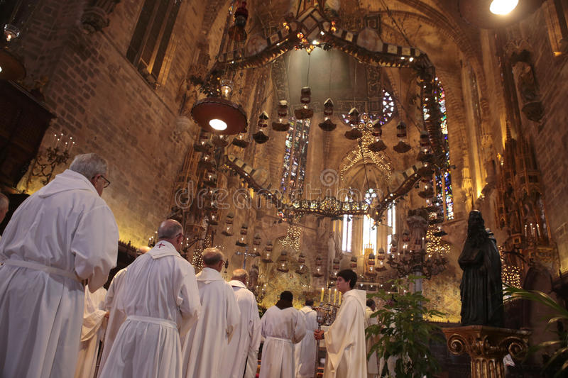 Priests at mass in Palma de Mallorca cathedral royalty free stock photo
