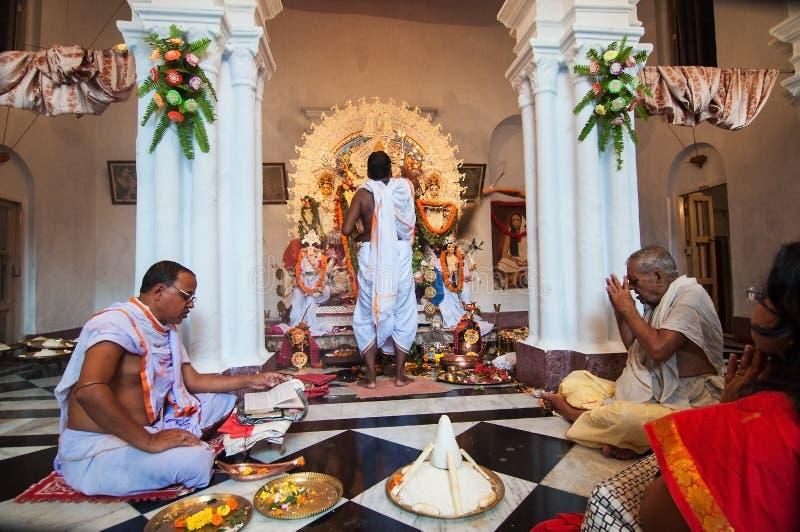 Priests praying to Goddess Durga stock photos