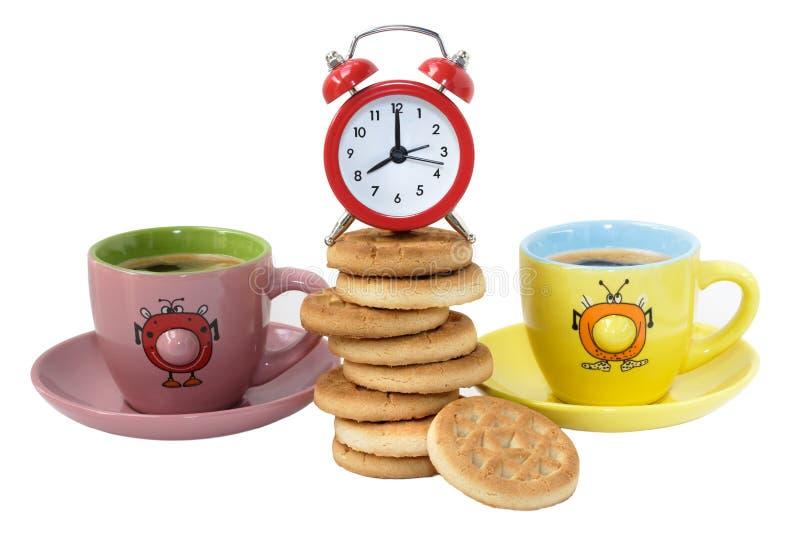 Prima colazione con i biscotti, il caffè e la sveglia fotografia stock