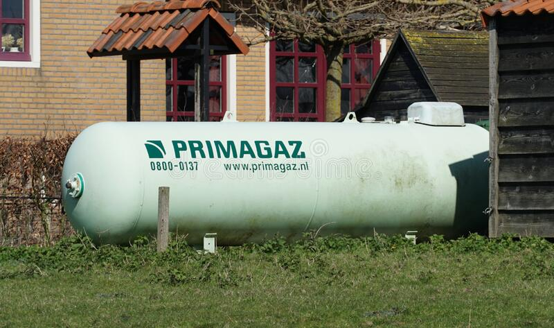 Primagaz tank. Pijnacker, the Netherlands. March 2020. Storage tank in a garden filled with propane or lpg, with the name of Primagaz on it royalty free stock photos