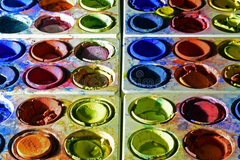 Primary colors water color paint boxes stock image