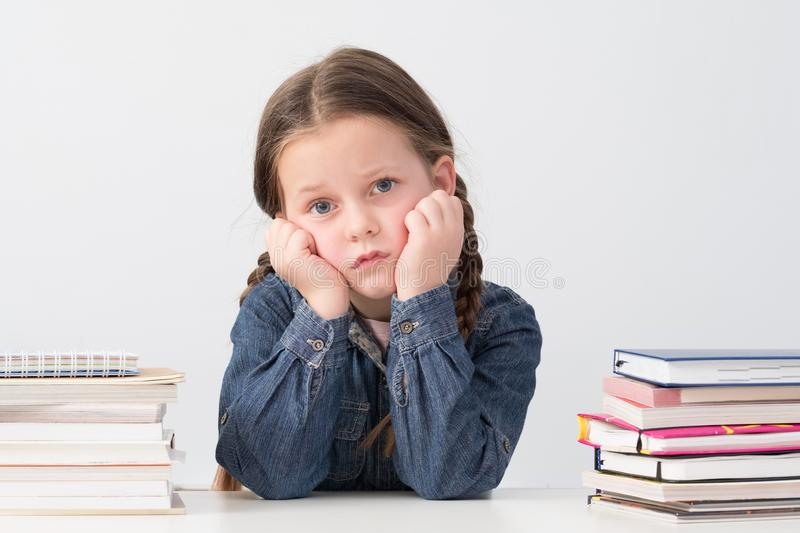 Primary education tired school girl book stacks royalty free stock photos