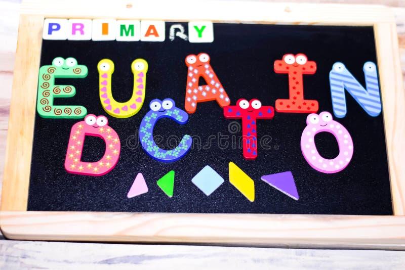 PRIMARY EDUCATION WRITTEN ON CHALK BOARD stock photo