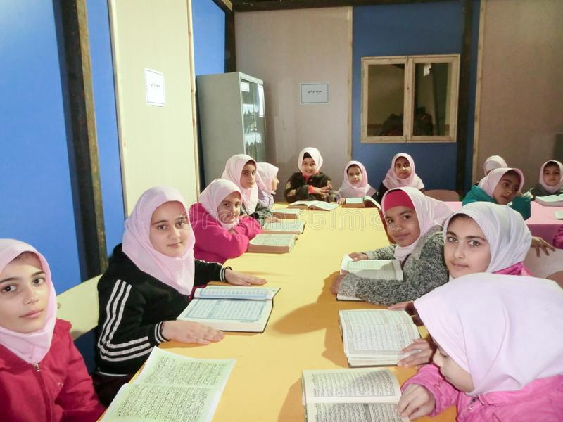 Primary school girls Studying book stock photos
