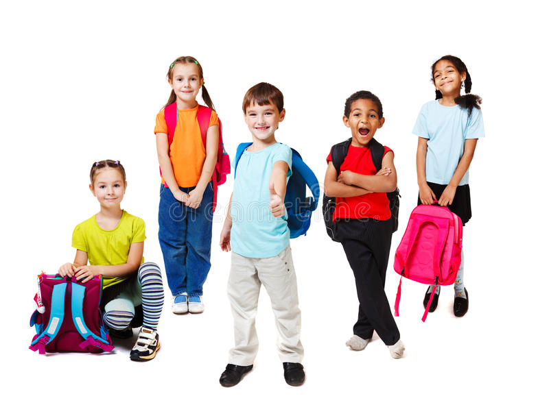 Primary school students. With backpacks royalty free stock image