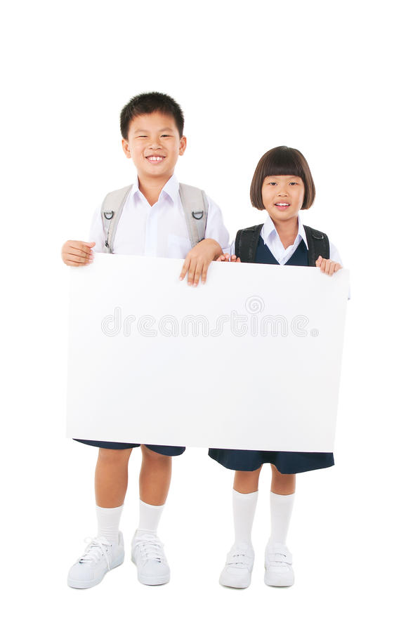 Primary school students. Asian primary school student holding white board royalty free stock photo