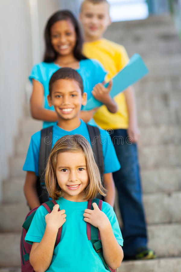 Primary school students. Standing in a row royalty free stock photos