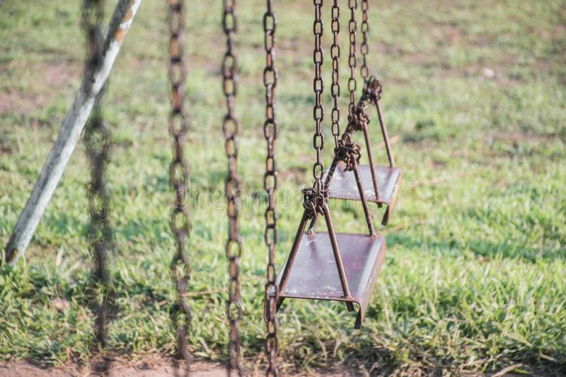 Primary school swings which are very old. stock photo