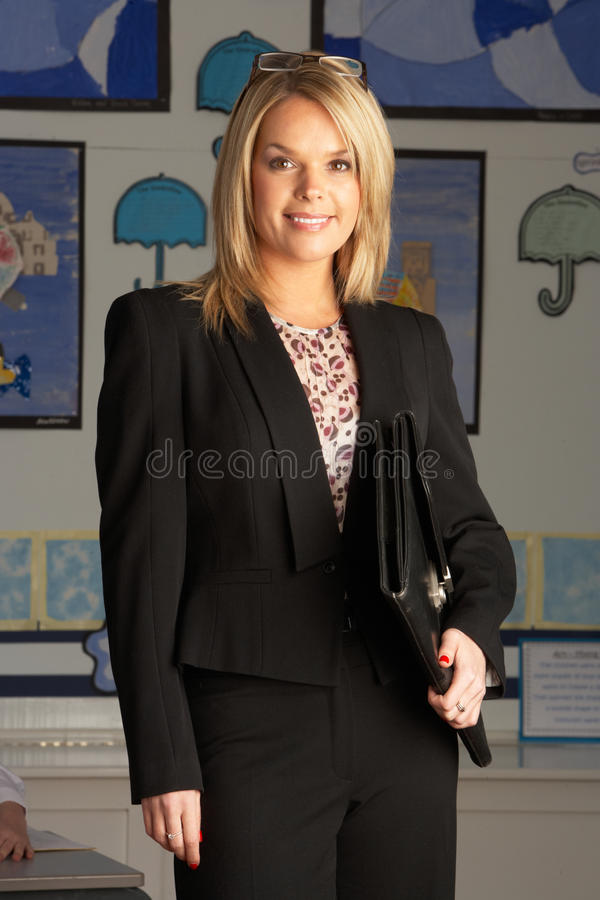 Download Primary School Teacher Standing In Classroom Stock Image - Image: 15540269