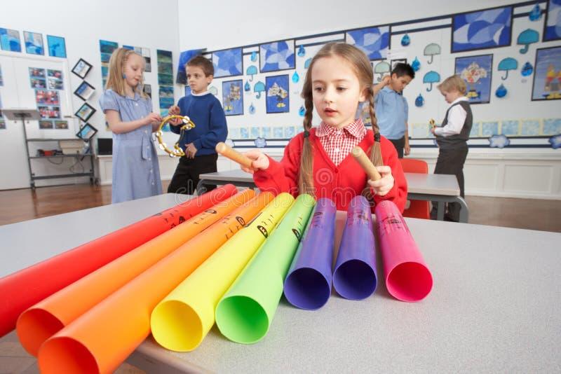 Primary Schoolchildren Having Music Lesson stock photo