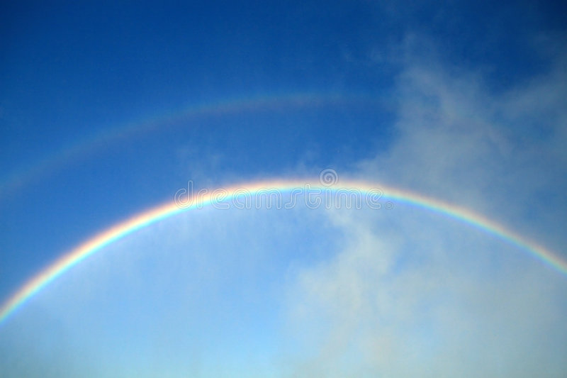 Primary and Secondary Rainbows. The mists of Niagara Falls displaying both primary and secondary rainbows stock images