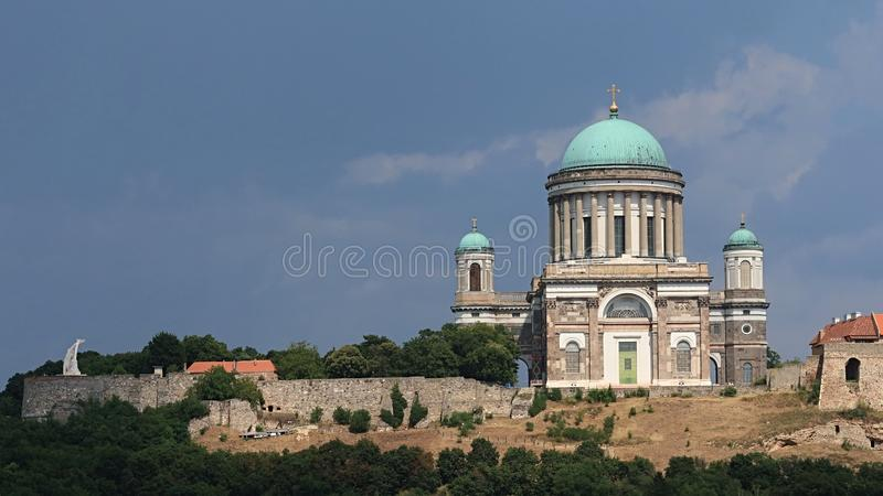 Primatial Basilica of the Blessed Virgin Mary Assumed Into Heaven and St Adalbert and Esztergom Castle. As viewed from Maria Valeria bridge between Sturovo and royalty free stock photography