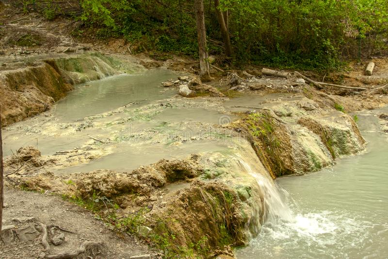 Primavera del agua termal de Bagni san Filippo imagen de archivo libre de regalías