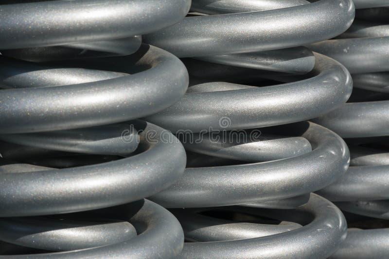 Primaveras de acero usadas en maquinaria pesada foto de archivo