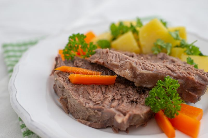 Prime boiled beef with root vegetables, Viennese Tafelspitz stock image