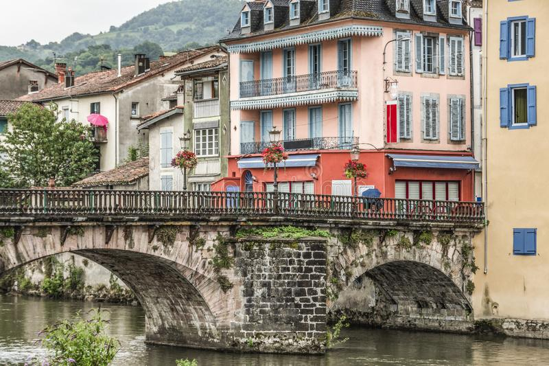 Prime plan of the old bridge over the river Salat and constructions in the central part of the old village of Saint Girons. Ariege. France stock images