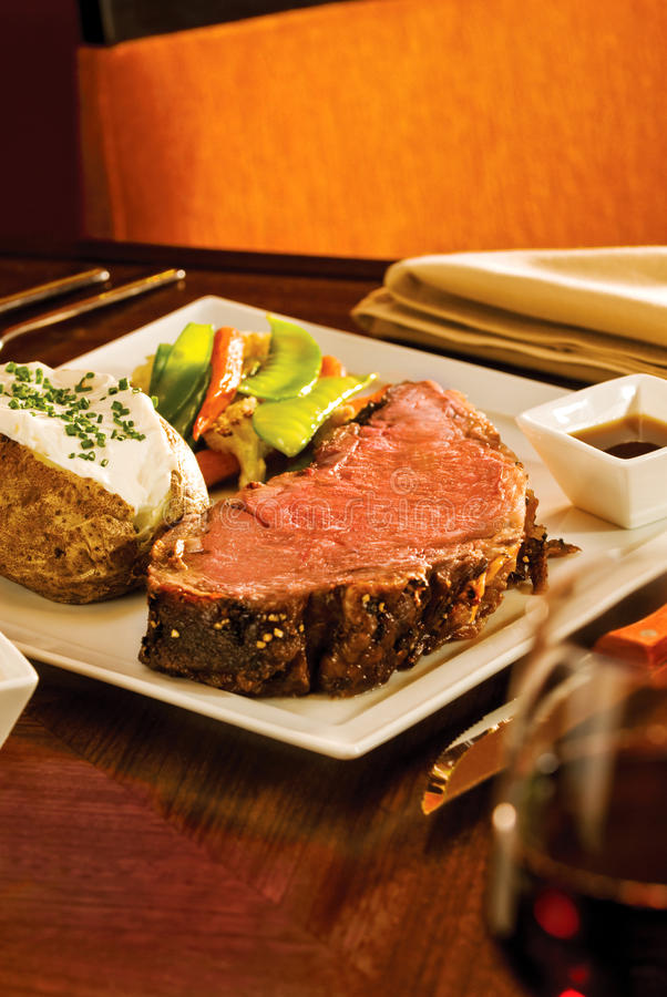 Prime Rib Dinner. A delicious Prime Rib dinner with potato and extras. Narrow focus on the meat royalty free stock photo