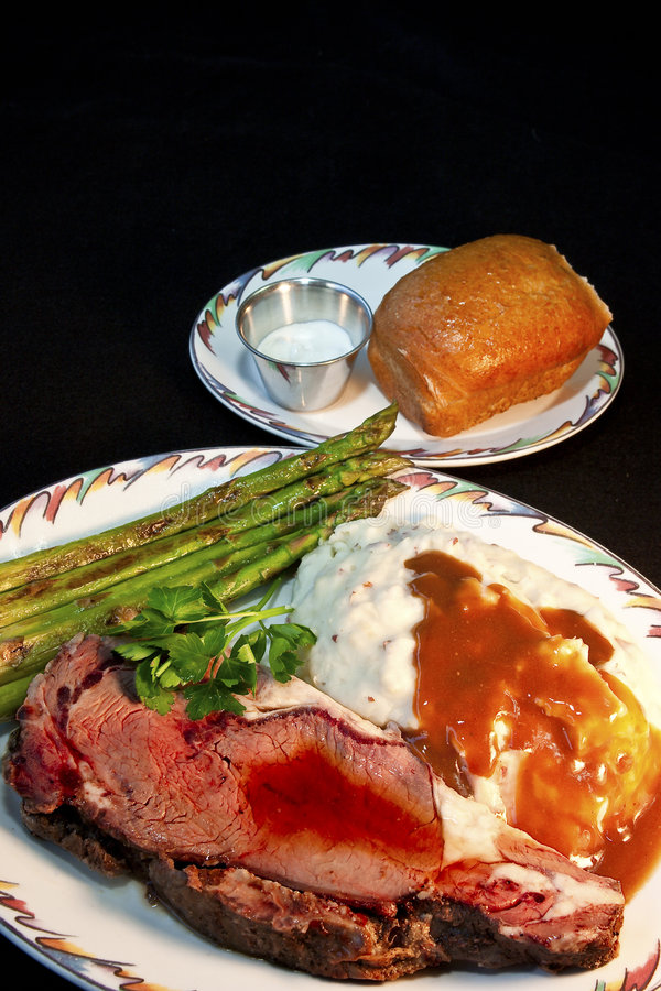 Prime Rib Dinner. Delicious Prime Rib Dinner with Asparagus and Mashed Potatoes royalty free stock image