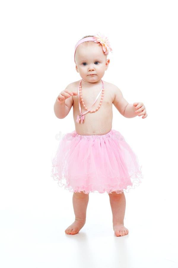 Primeiras etapas do bebê bonito no fundo branco fotos de stock royalty free