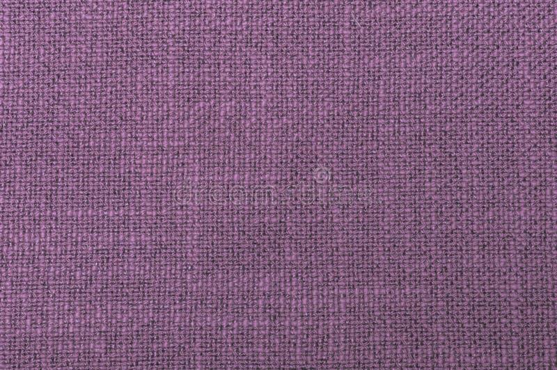 Primer áspero de la textura del hilo del color violeta de la materia textil que teje imagen de archivo libre de regalías