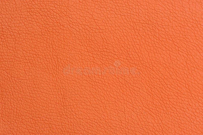 Primer anaranjado de la textura del fondo del cuero artificial imagenes de archivo