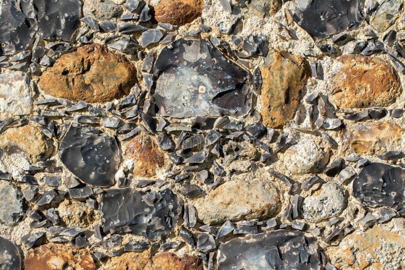 Primer antiguo de la superficie de la pared de piedra del pedernal Fondo abstracto I fotos de archivo libres de regalías