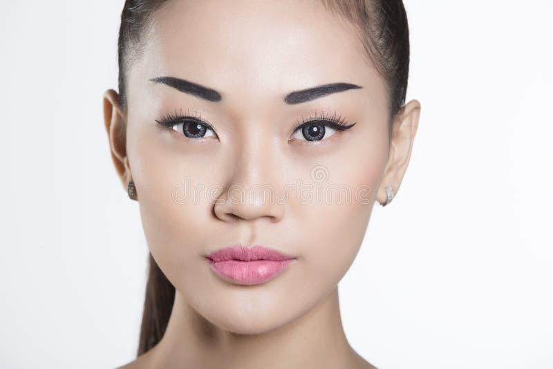 Primer asiático hermoso de la cara de la muchacha fotos de archivo libres de regalías