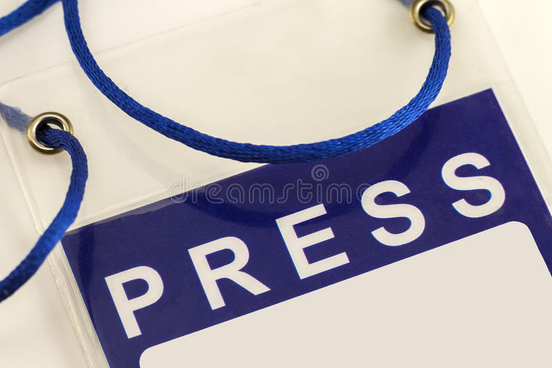 Primer azul de la tarjeta de la identificación del pase de prensa imagen de archivo