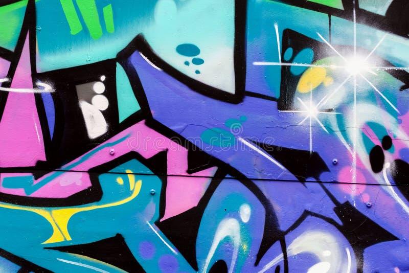 Primer colorido del estilo de la pintada del arte hermoso abstracto de la calle Detalle de una pared Puede ser útil para los fond fotos de archivo