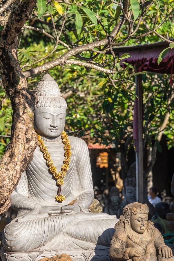 Primer de Buda en la tienda de la estatua en Denpasar, Bali Indonesia foto de archivo