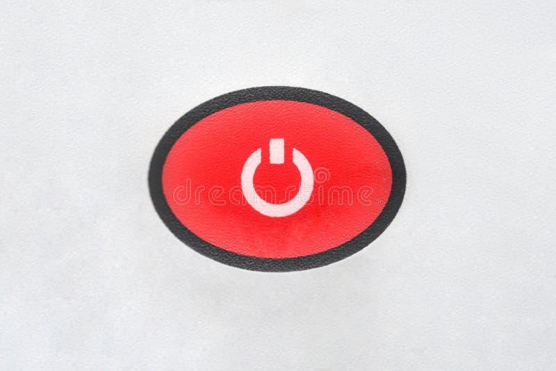 Primer de ciclo inicial del equipo del botón oval rojo en un fondo blanco fotografía de archivo libre de regalías