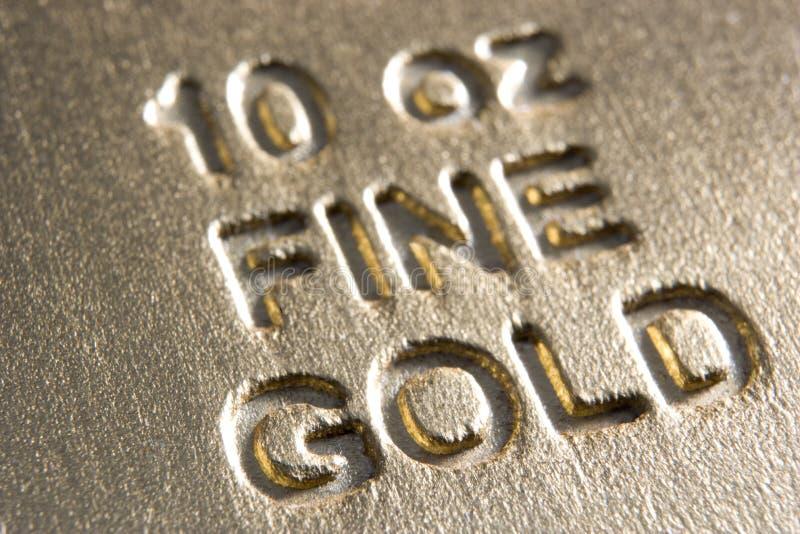 Primer de la barra de oro fotografía de archivo