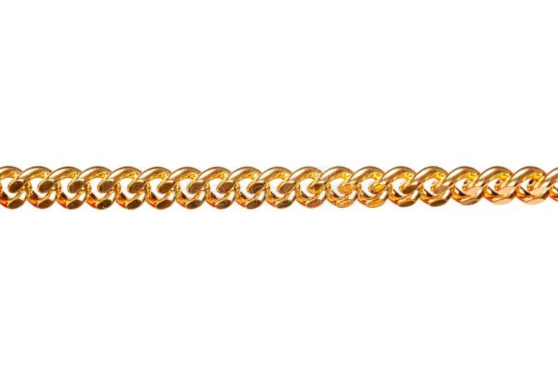 Primer de la cadena del metal del oro aislado en blanco fotos de archivo