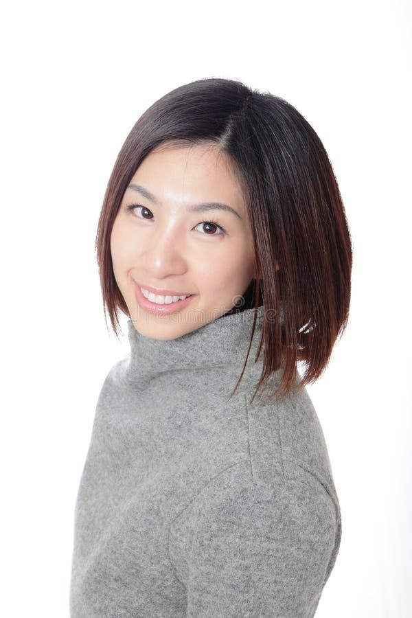 Primer de la cara bonita feliz de la sonrisa de la mujer fotografía de archivo libre de regalías