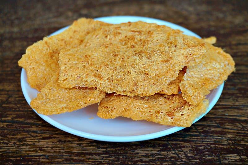 Primer de la galleta del arroz con cerdo sedoso imagenes de archivo
