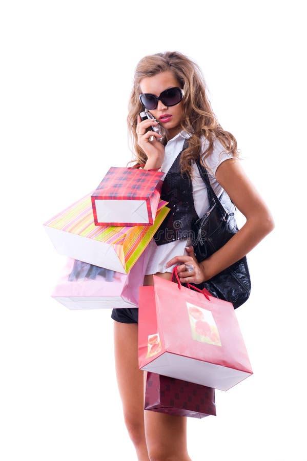 Primer de la mujer joven feliz en una juerga de compras. foto de archivo libre de regalías