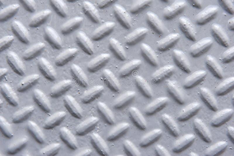 Primer de la superficie de metal pintada con el modelo de la raspa de arenque fotografía de archivo libre de regalías
