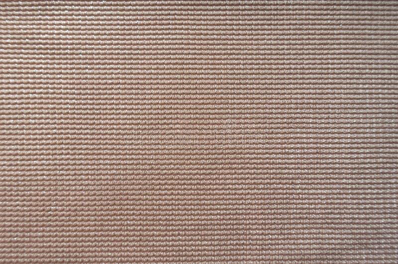 Primer de la superficie de la tela poner crema rosácea fotografía de archivo