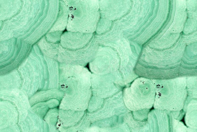 Primer de la textura inconsútil de la piedra verde de la malaquita foto de archivo