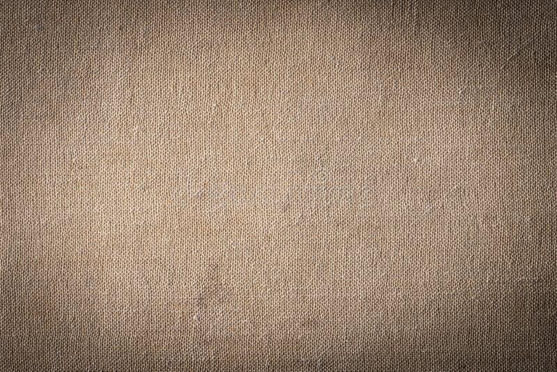 Primer de la textura marrón de la materia textil para el fondo imagen de archivo libre de regalías