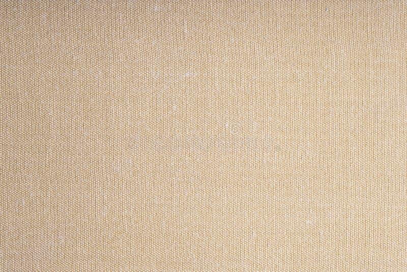 Primer de la textura marrón de la materia textil para el fondo fotografía de archivo libre de regalías
