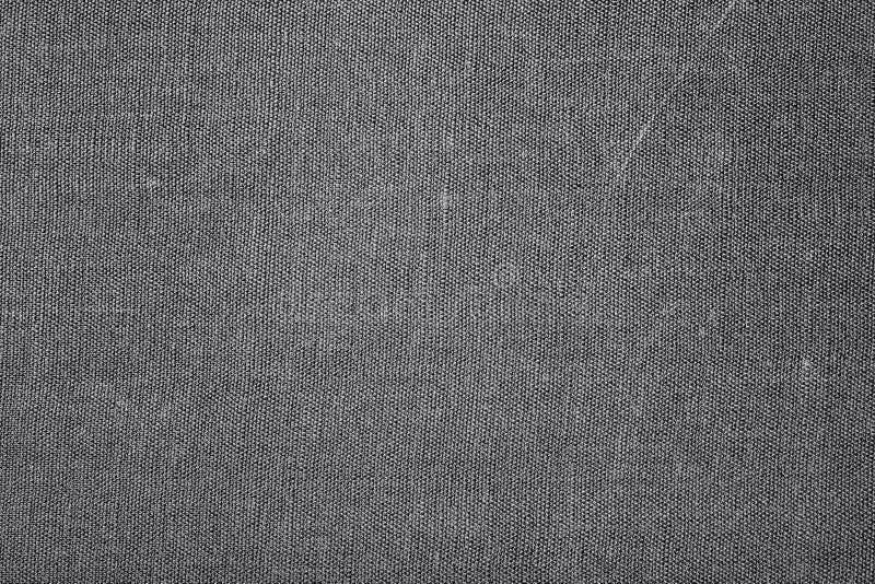 Primer de la textura negra de la materia textil para el fondo imagen de archivo libre de regalías